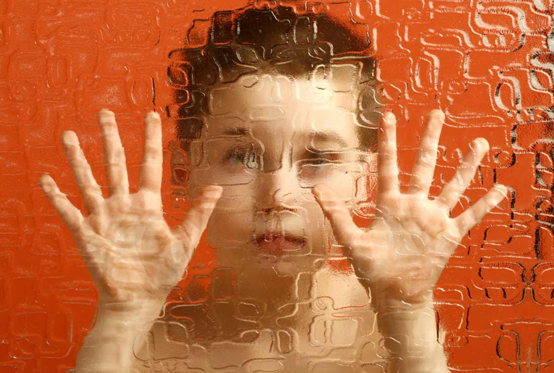 child-looking-through-wavy-glass